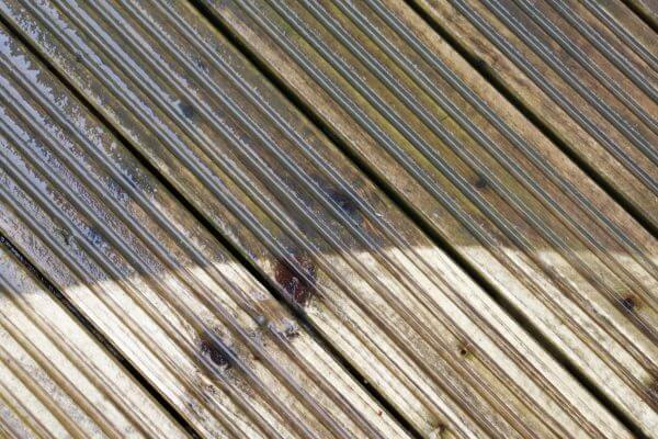 Wooden decking before and after cleaning